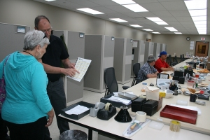 Tour attendees learn about how the grain grading process works.